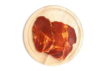 chopping board: Spiced steaks on chopping board