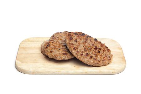 chopping board: Grilled steaks on chopping board