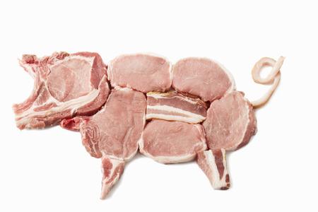 Pig von Schweinekoteletts, Filet und Speck auf weißem Hintergrund gemacht Lizenzfreie Bilder