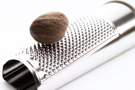 nutmeg: Nutmeg on grater