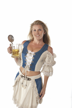 a jar stand: Woman in traditional german dirndl outfit with beer mug Stock Photo