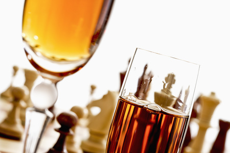 parlour games: Sherry glasses in front of chess board