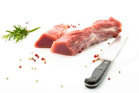 pork  loin: Pork loin and herbs, knife, white background
