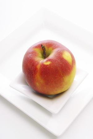 vitamines: Elstar apple on plate, elevated view