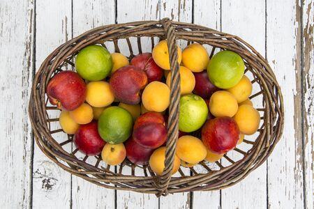 fruit basket: Fruit basket, nectarines, apricots and limes