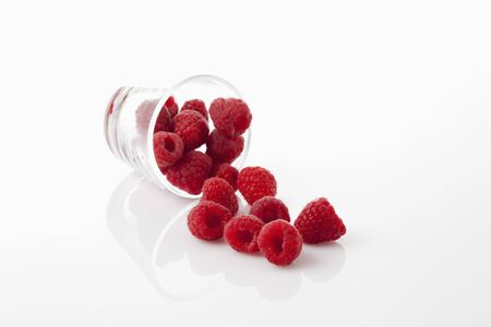 toppled: Glass with raspberries