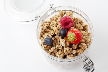 brittle: Opened glass with brittle muesli and forest fruits