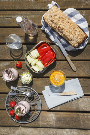 crudite: Picnic with wholemeal-wheat-spelt-bread, dips, crudites, strawberry-yogurt and lemonade Stock Photo