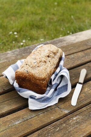 spelt: Wholemeal wheat spelt bread on wooden table