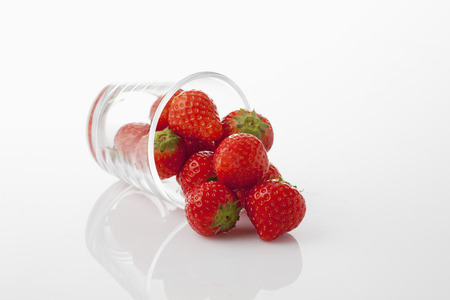 toppled: Glass with strawberries