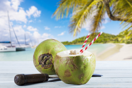 cleaver: Coconut on wood, cleaver and drinking straws, Caribbean beach