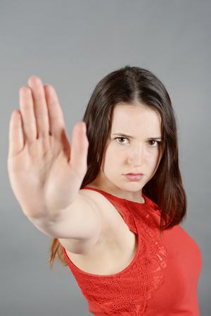 stop gesture: Young woman making stop gesture Stock Photo