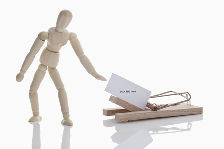 mousetrap: Wood puppet with mousetrap on white background