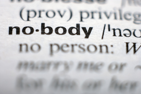 orthography: Extreme close up of english dictionary page with word nobody Stock Photo