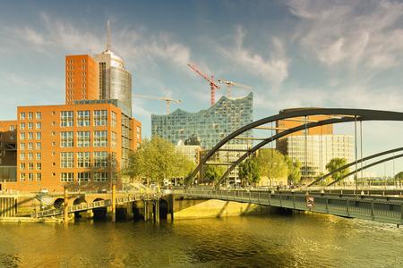 htc: view on the Niederbaumbridge and Kehrwiederspitze, HTC and landmark Elbphilharmonie in Hamburg, Germany