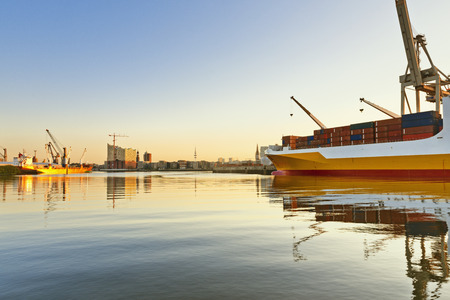 view on the Hansahafen with cargo ship in Hamburg, Germany Stock Photo
