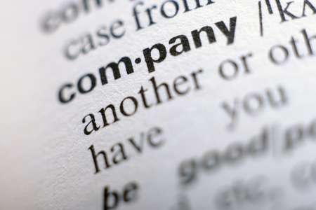 english dictionary: Extreme close up of english dictionary page with word company Stock Photo