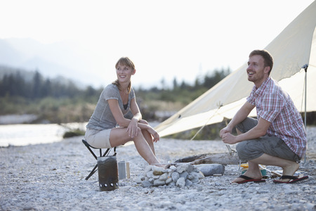 fringes: Couple smiling while camping