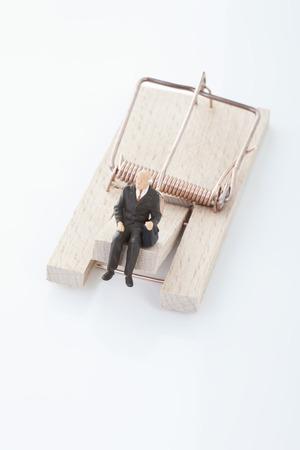 oldage: Figurine of man pensioner on mouse trap