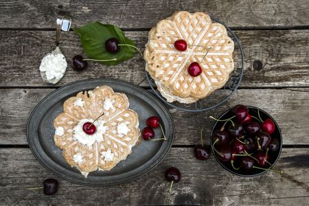 afters: Waffles with cherries on plate