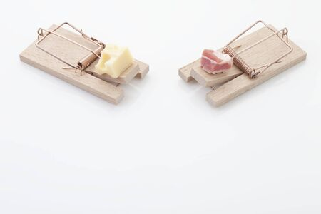 ploy: Pieces of cheese and ham on mousetrap Stock Photo