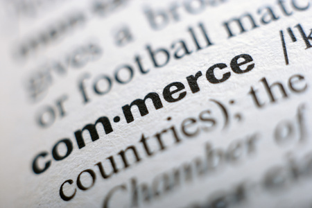 orthography: Extreme close up of english dictionary page with word commerce