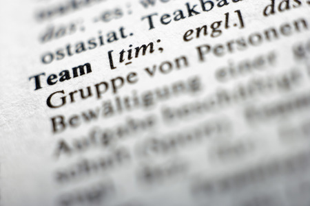 dictionary: Extreme close up of english dictionary page with word team Stock Photo