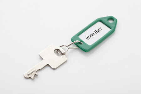 key ring: Key on key ring with text mein herz Stock Photo