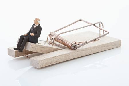 mouse trap: Figurine of man pensioner on mouse trap