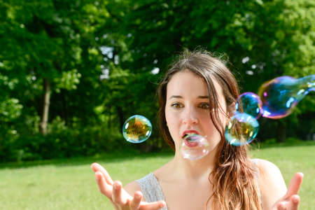 Young woman and soap bubbles Stock Photo