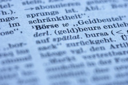 newsprint: Extreme close up of stock exchange dictionary in newspaper