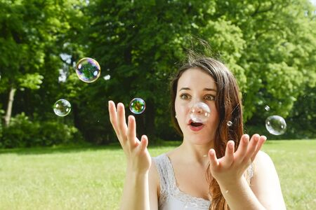 soap bubbles: Young woman and soap bubbles Stock Photo