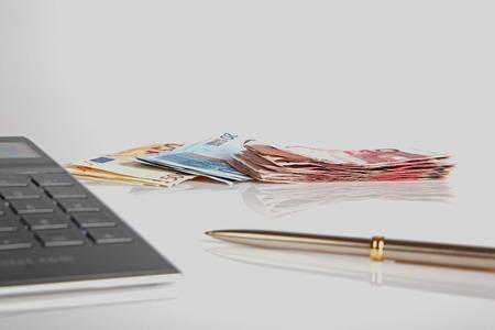 ballpen: Euro banknotes, calculator and ballpen Stock Photo