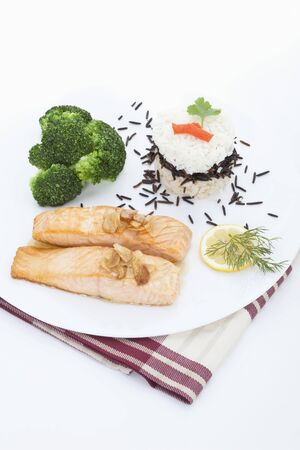 kept: Garnished salmon kept in plate,close up Stock Photo