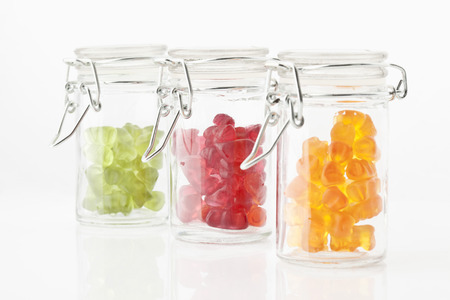 gummi: Variety of gummi bears in a preserving jar on white