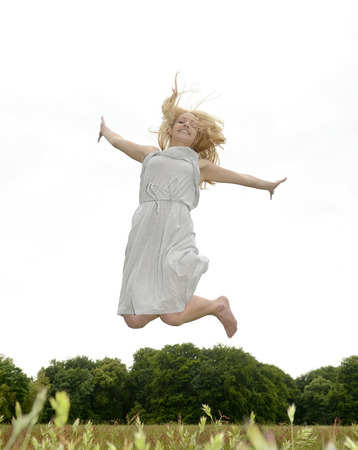 zest for life: Young woman jumping in park