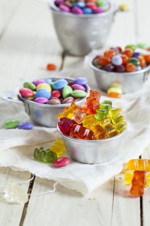 jellybean: Three different kind of candy, gummy bears, chocolate drops, jelly-beans Stock Photo