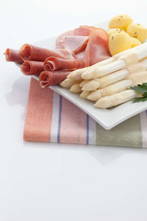 parma ham: Asparagus,potatoes,parma ham and parsley in plate on napkin