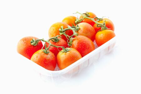 plastic container: Fresh tomatoes in plastic container on white