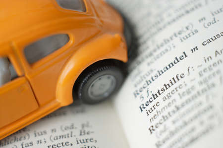 lexicon: Extreme close up of model car on dictionary