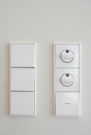 dimmer: Germany,Upper Bavaria,Munich,Close up of electric switch and dimmer switch against white wall