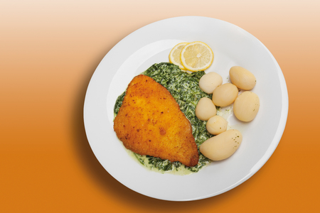 creamed: Breaded fillet of plaice with creamed spinach and boiled potatoes