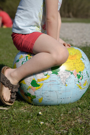ball: Germany,Bavaria,Ammer Lake,Girl sitting on earth beach ball