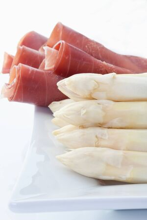 parma ham: Asparagus and parma ham in plate on white  Stock Photo