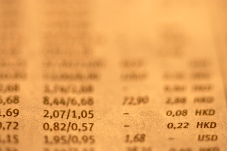 financial figures: Extreme close up of stock exchange financial figures in newspaper
