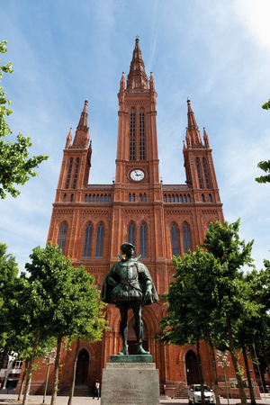 incidental people: Germany,Hesse,Wiesbaden,View of Cathedral Marktkirche with statue of William I in foreground