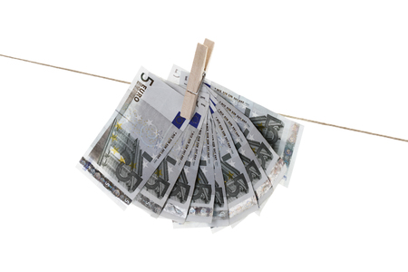 5 Euro bank notes hanging on clothesline Stock Photo