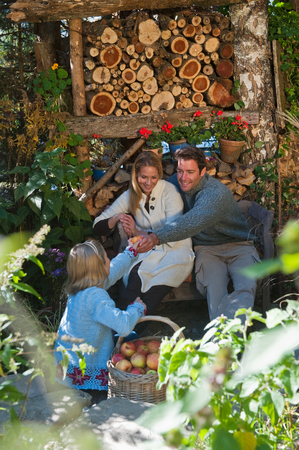 log basket: Austria,Salzburg,Flachau,Family in a farm garden
