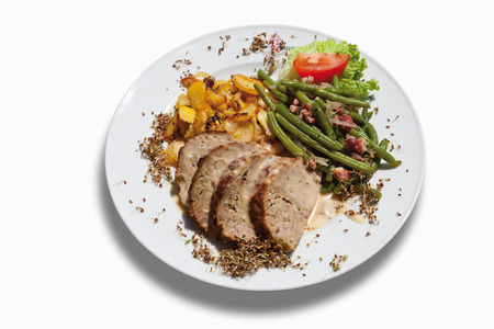 bratkartoffeln: Slices of meatloaf with fried potatoes and green beans in plate