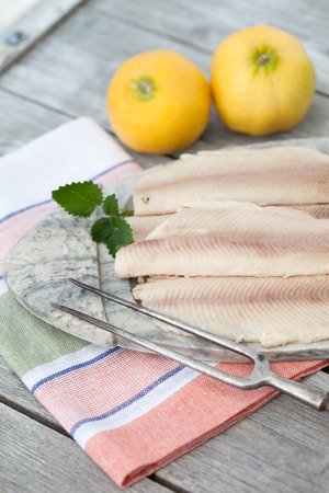 food       plate: Germany,Close up of trout fillets in plate with lemons